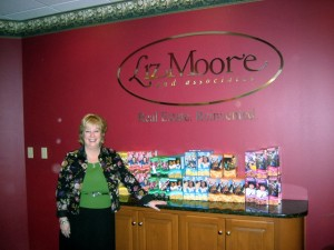 Liz Moore with the Girl Scout Cookies donated for our Troops!